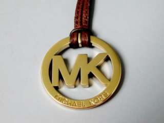 New Michael Kors Polished Gold MK with British Tan Leather Strap Hang