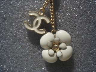 Authentic Chanel white CC Logo and Camellia Dangling Charm Earrings