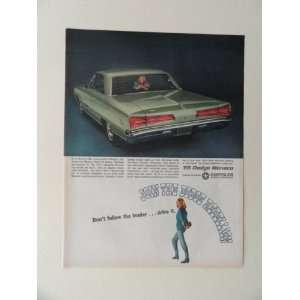 Dodge Monaco. full page print ad(green car/woman.) original vintage
