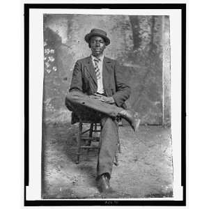 Portrait of African American man,Seated,wearing top hat