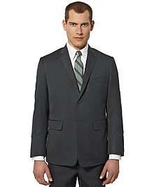 Worsted wool. Three button roll over lapel, side vents. Genuine horn